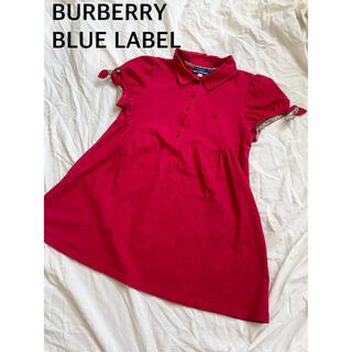 バーバリーブルーレーベル(BURBERRY BLUE LABEL)のBurberry ポロシャツ Aライン サイドリボン ノバチェック 赤(ポロシャツ)