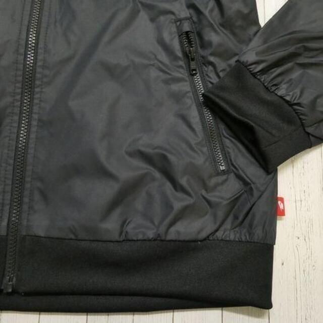 NIKE(ナイキ)のNIKE ナイキ ウィメンズ ウインドジャケット ウインドブレーカー L 白黒 レディースのジャケット/アウター(ナイロンジャケット)の商品写真