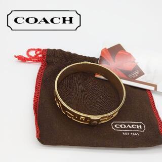 コーチ(COACH)のコーチ バングル 金色 ブレスレット ロゴ(ブレスレット/バングル)