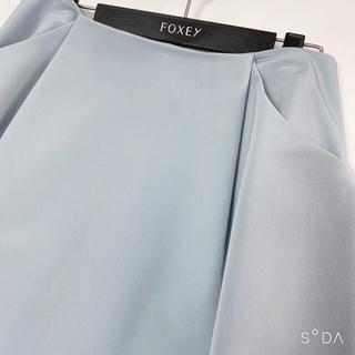 フォクシー(FOXEY)の✨ フォクシーニューヨーク イリプスロングスカート ソフィブルー 40美品(ひざ丈ワンピース)