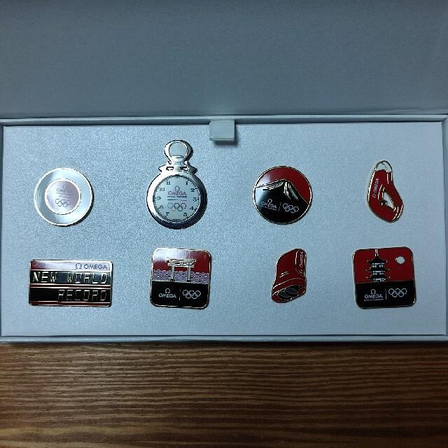 OMEGA(オメガ)のオメガ東京オリンピックピンバッジ(非売品) メンズの時計(腕時計(アナログ))の商品写真
