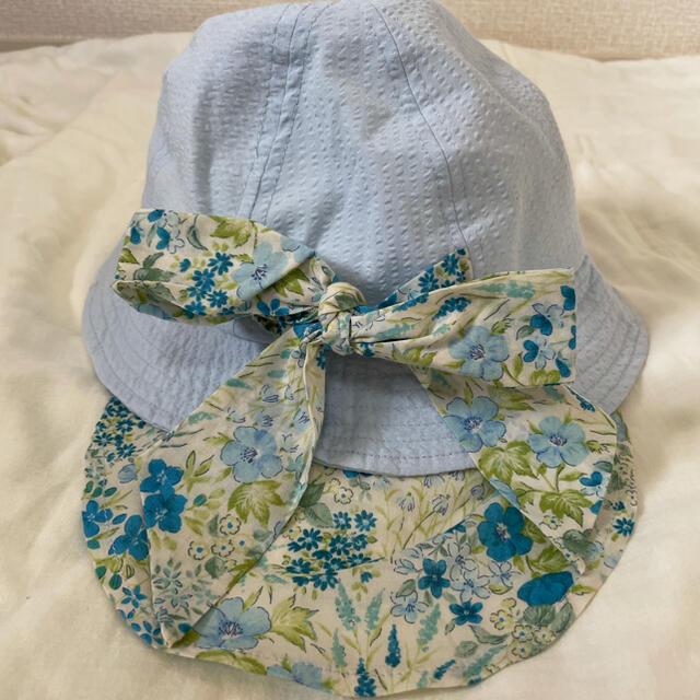 Branshes(ブランシェス)の【新品未使用】ブランシェス 帽子 52センチ 日除けハット 花柄 青 UV キッズ/ベビー/マタニティのこども用ファッション小物(帽子)の商品写真