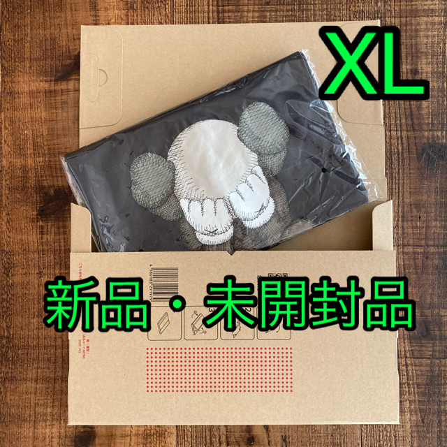 UNIQLO(ユニクロ)のユニクロ カウズ コラボTシャツ XL      ダークグレー 新品・未開封品 メンズのトップス(Tシャツ/カットソー(半袖/袖なし))の商品写真