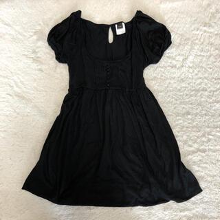 ダブルスタンダードクロージング(DOUBLE STANDARD CLOTHING)のダブスタ フレアトップ 黒 パフスリーブ くるみボタン ロングトップス 袖口(カットソー(半袖/袖なし))