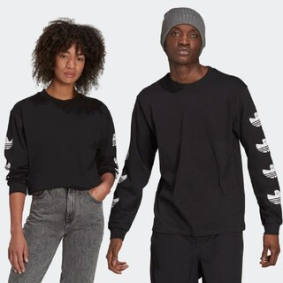 アディダス(adidas)のシュムーフォイル ロゴTシャツ(ジェンダーニュートラル)(Tシャツ/カットソー(七分/長袖))