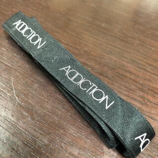 アディクション(ADDICTION)のブランドリボン(ショップ袋)