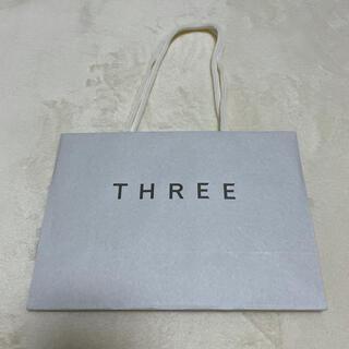 スリー(THREE)のスリー 紙袋 ショッパー袋(ファンデーション)