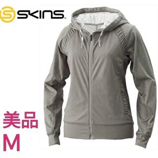 スキンズ(SKINS)のSKINS レディース パーカー フードジャケット グレー Mサイズ(パーカー)