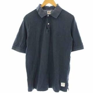 ステューシー(STUSSY)のステューシー ポロシャツ スカルプリント 半袖 コットン S 紺(ポロシャツ)