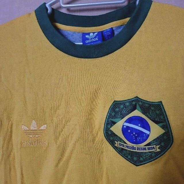 adidas(アディダス)のアディダス オリジナルス ブラジル代表デザイン Tシャツ M 新品 紙タグ付き メンズのトップス(Tシャツ/カットソー(半袖/袖なし))の商品写真