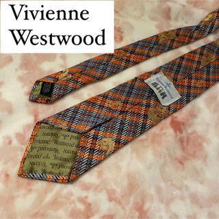 ヴィヴィアンウエストウッド(Vivienne Westwood)のヴィヴィアン ネクタイ メンズ 総柄 魚 船 ゴールド 派手好き(ネクタイ)