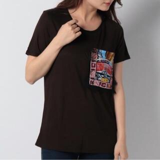 デシグアル 新品‼️ポケットにポスターの柄をあしらったレーヨン地Tシャツ