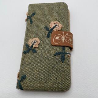 ミナペルホネン(mina perhonen)のiPhoneXSケース ミナペルホネン生地skip   ハンドメイド(iPhoneケース)