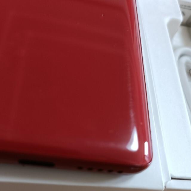 Rakuten(ラクテン)のRakuten Hand クリムゾンレッド 中古 スマホ/家電/カメラのスマートフォン/携帯電話(スマートフォン本体)の商品写真