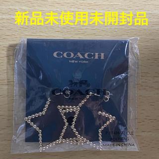 コーチ(COACH)の新品未使用未開封品 COACH 星形ピアス(ピアス)