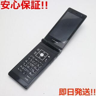 フジツウ(富士通)の美品 F-01E ブラック 白ロム(携帯電話本体)