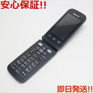フジツウ(富士通)の美品 F-01G らくらくホン ベーシック4 ブラック (携帯電話本体)