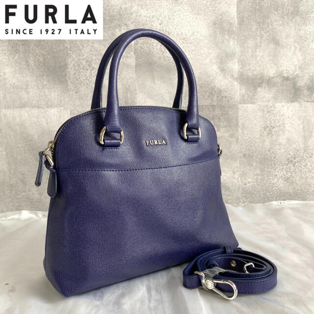 Furla(フルラ)の【美品】FURLA フルラ 2way レザー ハンドバッグ ネイビー 保存袋付き レディースのバッグ(ハンドバッグ)の商品写真