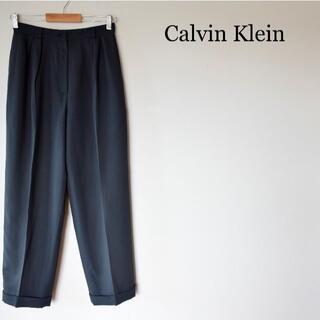 カルバンクライン(Calvin Klein)のCalvin Klein センタープレス 裾ダブル ワイド パンツ スラックス(カジュアルパンツ)