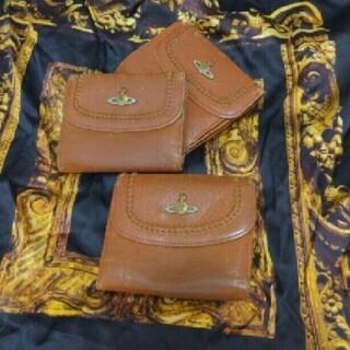 Vivienne Westwood - エナメルオーブボタンの折り財布 ヴィヴィアン