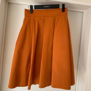 フォクシー(FOXEY)のFOXEY NEWYORK グログランフルタックスカート 40 オレンジ(ひざ丈スカート)