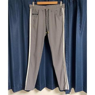 1piu1uguale3 - RESOUND CLOTHING サイドライントラックパンツ 美品