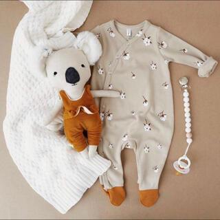 キャラメルベビー&チャイルド(Caramel baby&child )の新品 organiczoo コットンフラワー柄 ロンパース 6-12M(ロンパース)