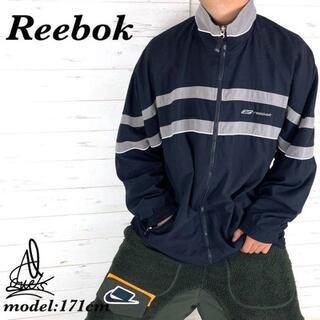 リーボック(Reebok)の《鉄板品》Reebok リーボック ナイロンジャケット L☆ブラック 黒 刺繍(ナイロンジャケット)
