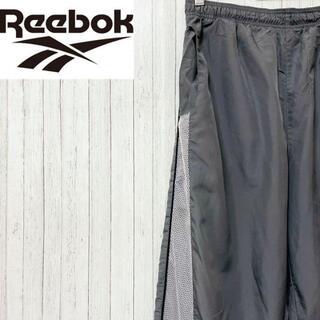 リーボック(Reebok)のリーボック ナイロンパンツ ジャージ 刺繍ロゴ グレー スポーツ M(その他)