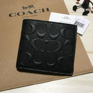 コーチ(COACH)の新品 COACH コーチ 折り財布 エンボス ブラック 黒色(折り財布)