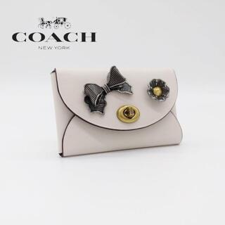コーチ(COACH)のコーチ カードケース 名刺入れ リボン 白 花 フラワー(名刺入れ/定期入れ)