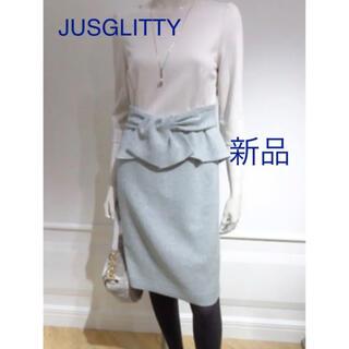 ジャスグリッティー(JUSGLITTY)の新品 JUSGLITTY 前リボンペプラムタイトワンピース(ひざ丈ワンピース)