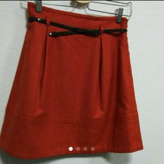 デンドロビウム(DENDROBIUM)のリボンベルト付き スカート オレンジ(ひざ丈スカート)