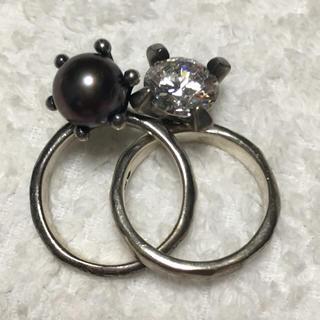 イーエムノアール(e.m. noir)のe.m. ブラックパール&ジルコニア クロスリング(リング(指輪))