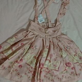 リズリサ(LIZ LISA)の新品タグあり リズリサ BOOKアリス柄 サスペンダー付きスカート ピンク(ひざ丈スカート)